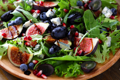 salad with figs and cheese on plate